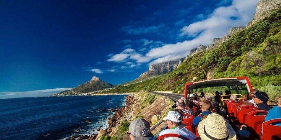 Tourists on an open-top sightseeing bus in Cape Town.