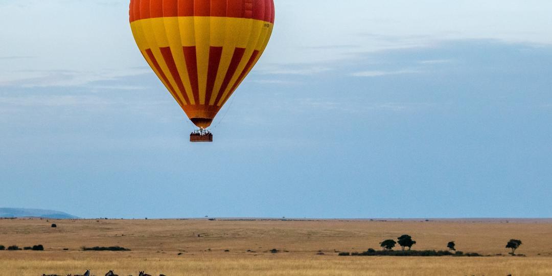 Hot-air balloon floating over the Maasai Mara